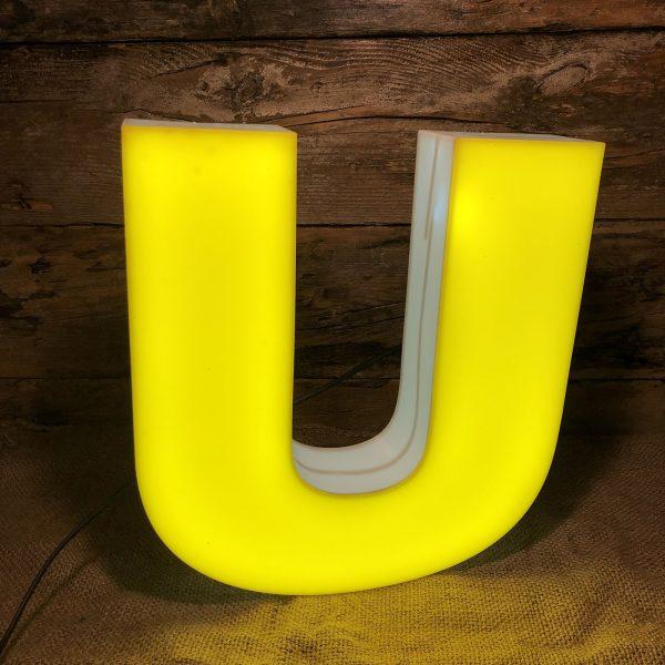 U insegna vintage plexiglass bianco giallo