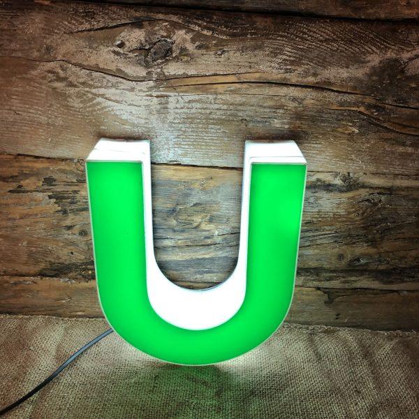 U insegna vintage luminosa verde bianco