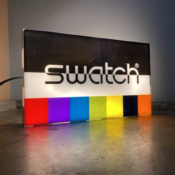 scatola orologio swatch illuminata